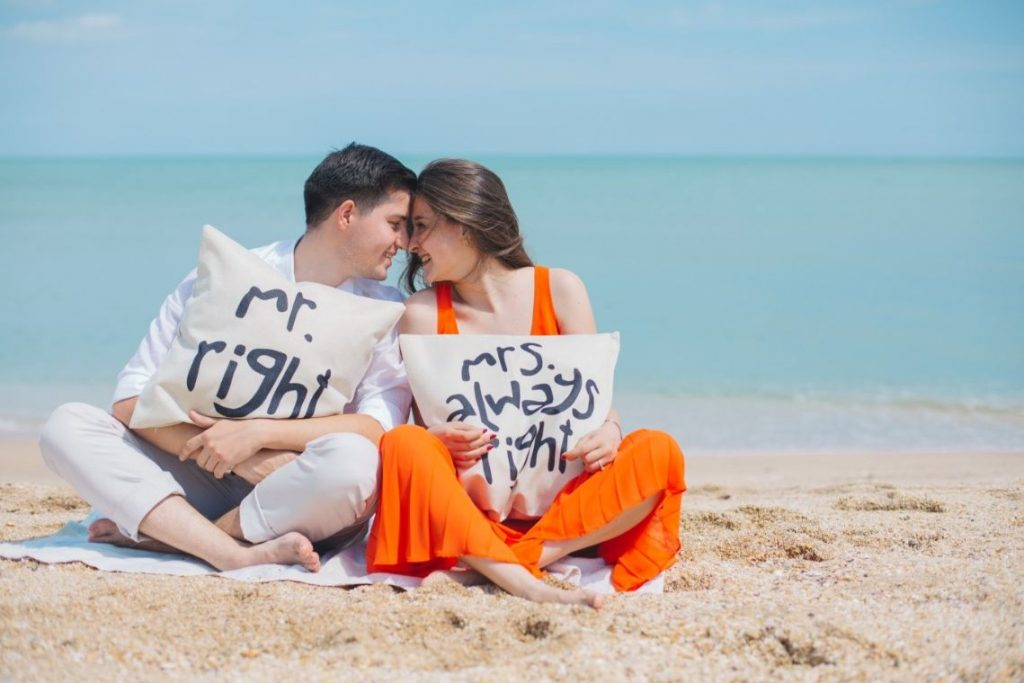 A Couple is sitting on beach