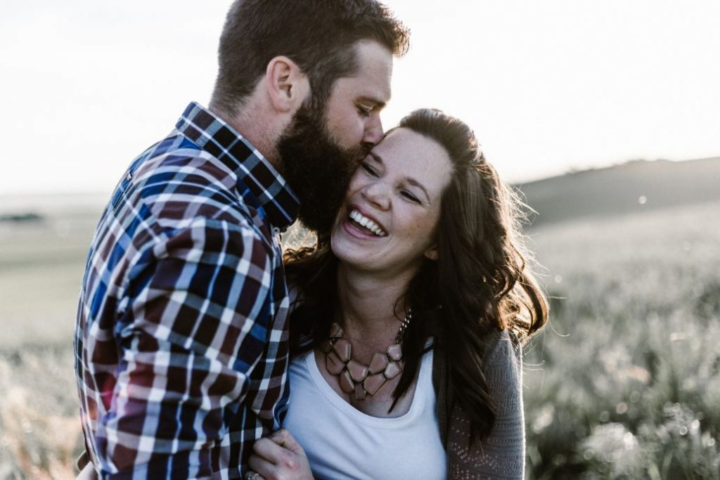 Bearded man showing love to his Girl