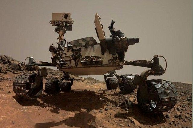 Curiosity rover Wandering on Mars to Gather Data of Planets Atmosphere and Land