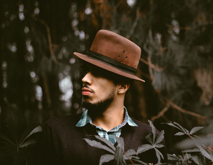 Vintage Style look of a man wearing hat and sweater.