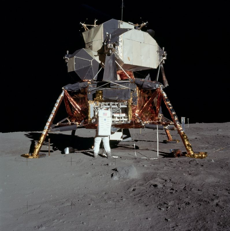 Astronaut analyzing Lunar Lander (Mission to Moon)