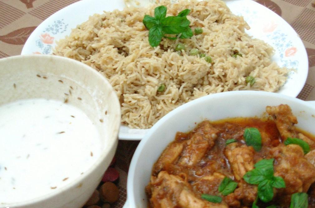 Hyderabadi Chicken Curry and Rice served with yogurt raita