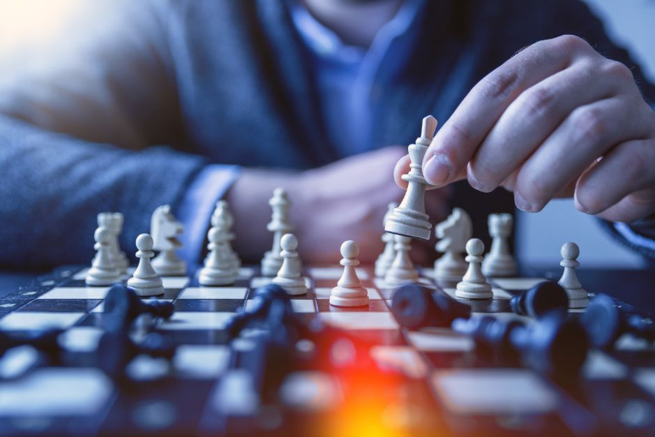 A man playing chess in leisure with his friend - Stress Relief Activities | Blurbgeek